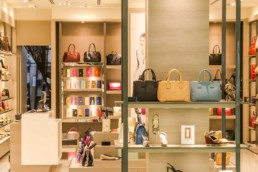 An image of handbags and shoes in a shop
